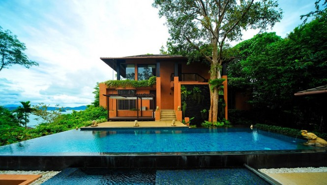 Generous infinity pools flank the dual level pads, offering a place to take a cool dip under the blazing sunshine, or shaded by the adjacent lush trees.
