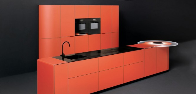 Orange colored curved kitchen