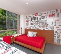 In the bedroom the typographical approach continues with statement feature wall and desk coverings.