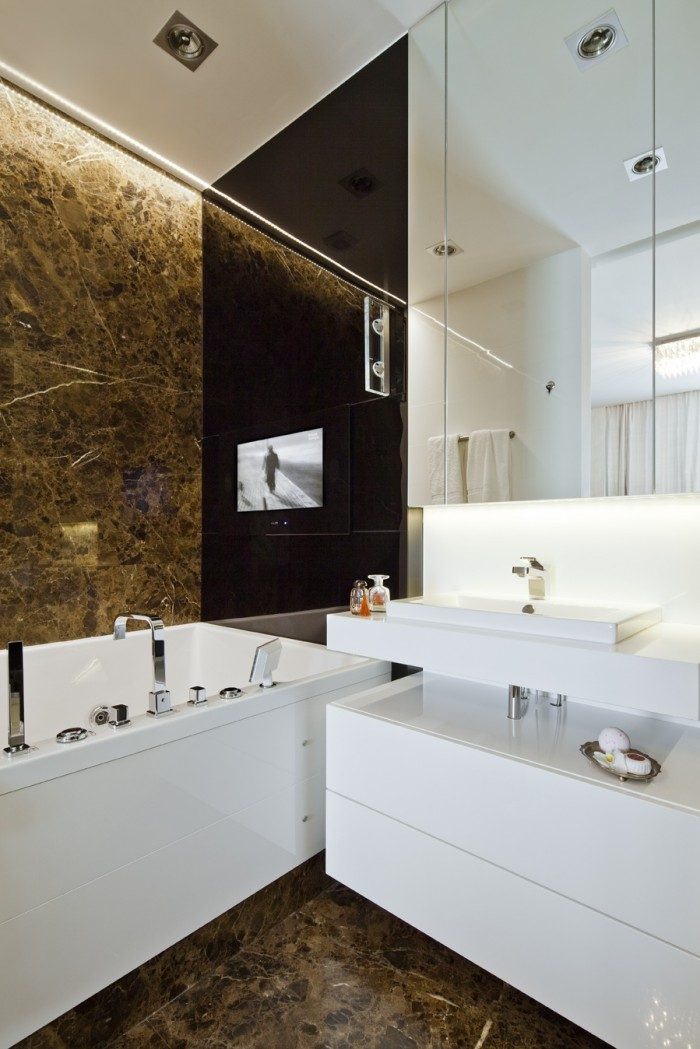 In the ensuite bathroom an Aqua TV has been situated above the generous tub for catching up on the latest news.