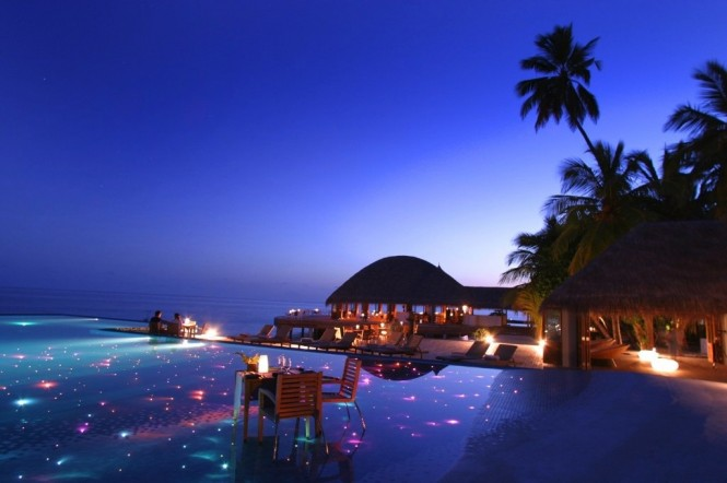 Take in a magical sunset at Huvafen Fushi Resor, Maldives.
