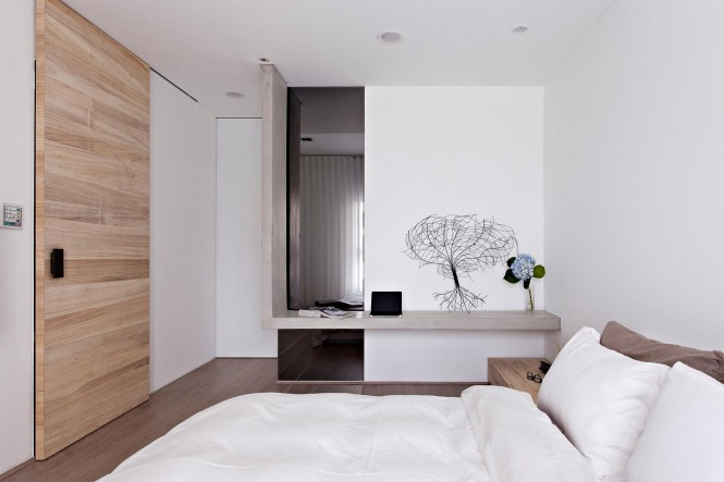 White wood concrete bedroom