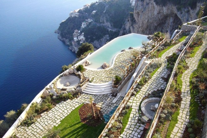 Majestically overlooking the ocean, the multilevel patios of Monastero Santa Rosa in Italy has views upon views.
