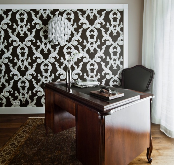 A home office area with a sturdy antique-style desk allows for catching up on paperwork out of hours.