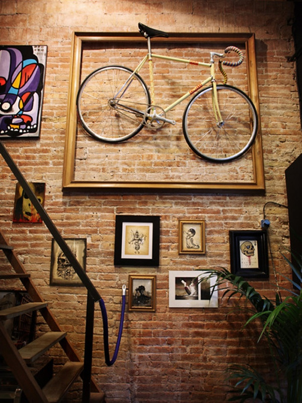 Via Cream Bikes and ThingsA huge frame makes a masterpiece out of your old bicycle, or a very arty storage space for your current one!