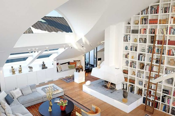 Via TrendlandHigh walls can, and should be, utilized as extended storage areas; an ideal example of this is the installation of a home library that not only takes full advantage of the added stacking space but looks attractive, warm and homey as well. Don't forget the addition of a home library ladder too though or you will be left feeling frustrated every time you find the need to get the step ladders back out of the shed to reach that much needed hardback edition on a high shelf; top shelves up in the rafters can be used for storing little used keepsake editions that you just can't seem to bare to part with, or for displaying art and artifacts far from the reach of clumsy visitors!