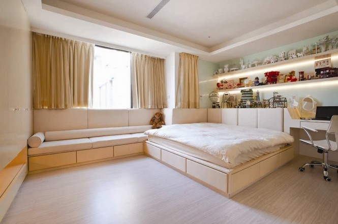 Solid wood flooring has been installed in the serene bedroom schemes, decked out in walls of calming cream.