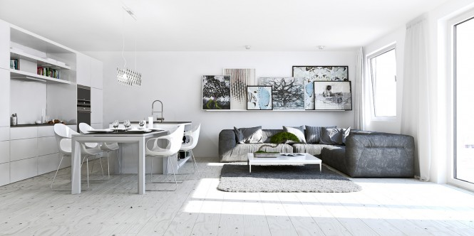 This compact studio apartment packs in an art collection propped along a picture ledge to breathe life into the laid-back lounge space.