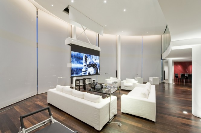 When you're done lounging in the cinema area of this homes vast reception room, you can work up a sweat in a luxurious residents' gym or take a plunge in the swimming pool.