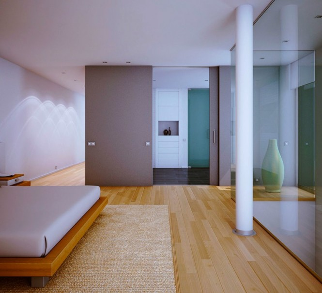 An ensuite bathroom and dressing area lies beyond a large sliding door