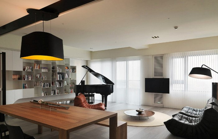 One of the most eyecatching black accent pieces in the place comes in the stunning form of a grand piano-a thing of beauty whether you are a classically trained musician or just tinkle the keys for kicks!