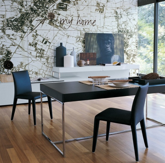 The sleek lines of this modern dining suite contrasts against the organic shapes that lie beyond the glass, though a map wall mural connects the décor to it's surroundings.