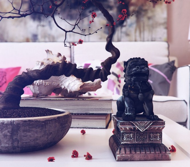 A bonsai tree is the perfect addition to an Eastern inspired space to promote sense of calm and wellbeing, and a classic Asian statue is the cherry on the cake.