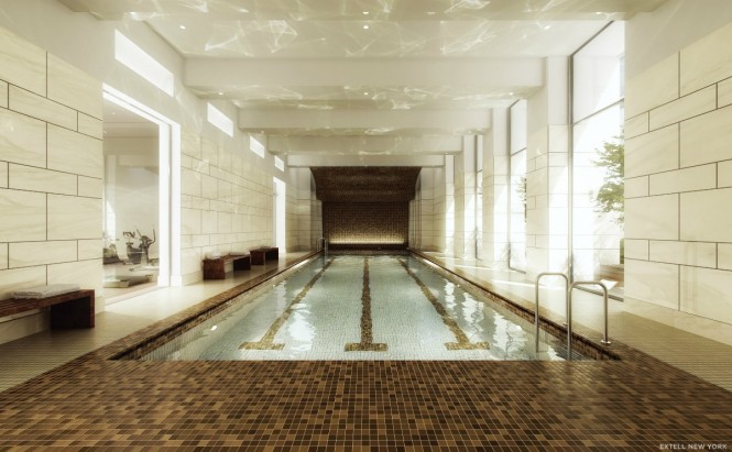 Surrounded by swathes of tiny mosaic tiling, the rippling water of this indoor swimming pool makes you want to dive right in! Note how the sunlight reflects from the waters surface up over the high ceiling and glossy walls.