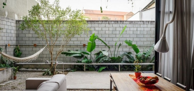 The home opens out into the courtyard space, where a hammock invites you to spend a little time closer to nature.