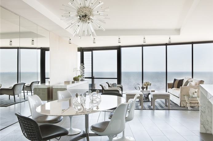 Soft, natural hues have been introduced to the interior via carefully selected pieces, which play upon the panorama beyond the windows; using muted blues, greens and sandy shades to subtly lift the simple white backdrop, the design leaks the beautiful horizon indoors.