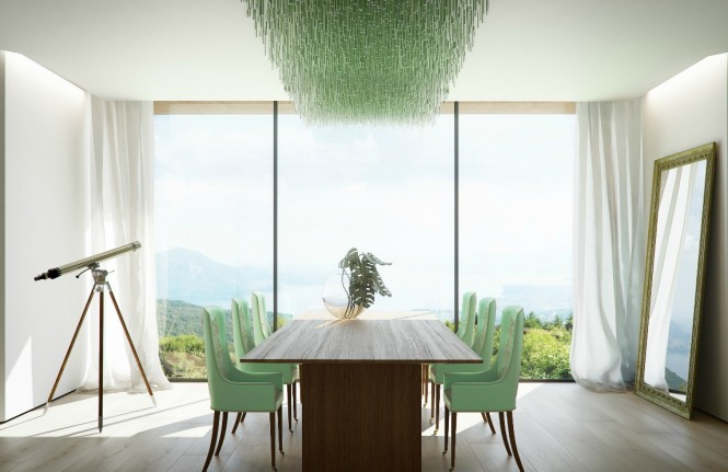 The minty hue used in this fresh dining space works perfectly with the tones over the landscape beyond.