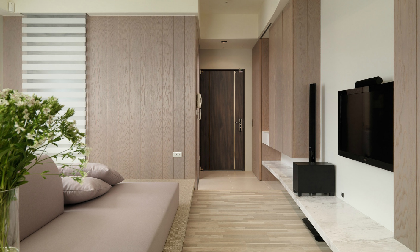 wall of wood cladding matches the finish of the wooden cabinetry to