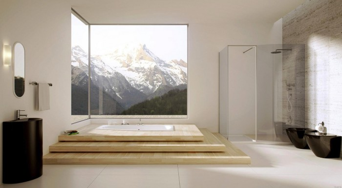 A mountain retreat boasts an awe-inspiring visage about a raised soaking tub. The bathrooms white, black and natural wood elements provide a stunning interior view.
