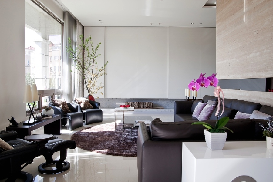 The Marble Walls And Floor In This Elegant Contemporary Living Room