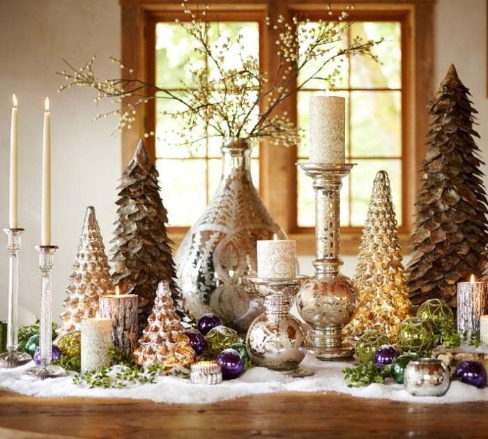 This tablescape gets it right with varying heights of decorative trees, candle holders and tiny décor items.