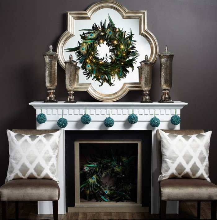 A contemporary mantel gets dressed with a simple silver wreath flanked by two stark Christmas trees.