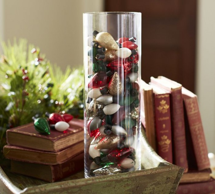 This vase of colorful bulbs shows a clever way to repurpose old Christmas decorations.