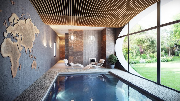 The ceiling application in the home's indoor spa arches over the pool and is mimicked by the oval window overlooking the gardens. The map is cut from a sheet of brass.