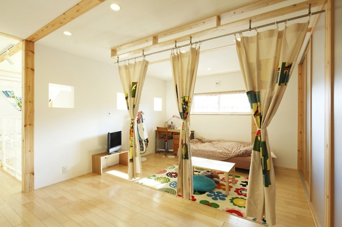 While white and neutrals dominate minimalist design, brilliant colors sparingly used can be found as seen in this Japanese child's bedroom.