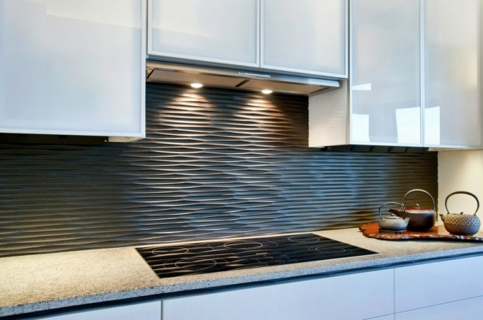 This wavy backsplash in graphite adds texture and interest to a white kitchen.