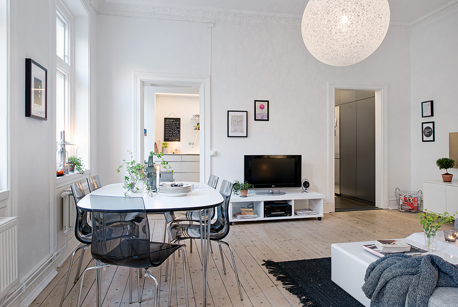 Swedish apartment boasts exciting mix of old and new for Dining ideas for small apartments