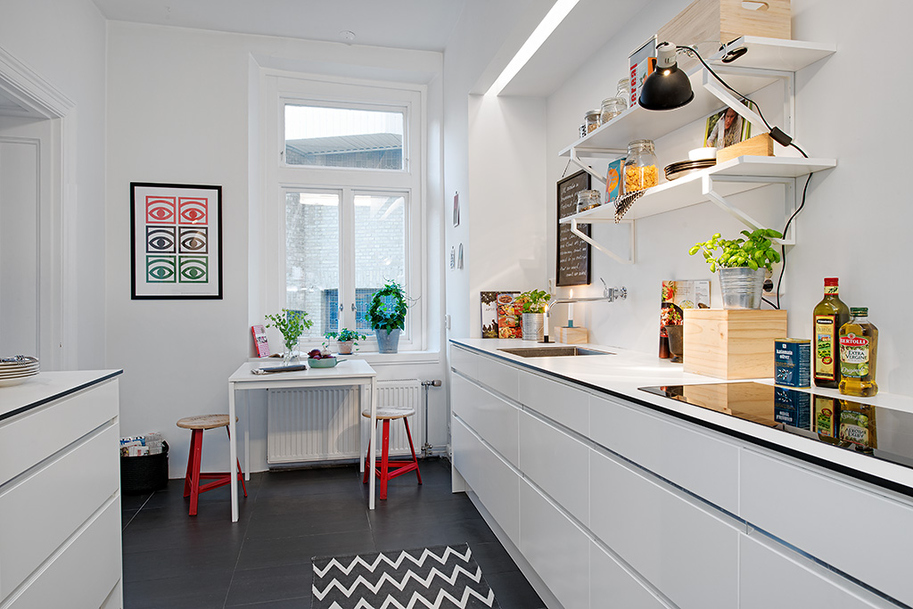 Swedish apartment boasts exciting mix of old and new for Galley kitchen designs