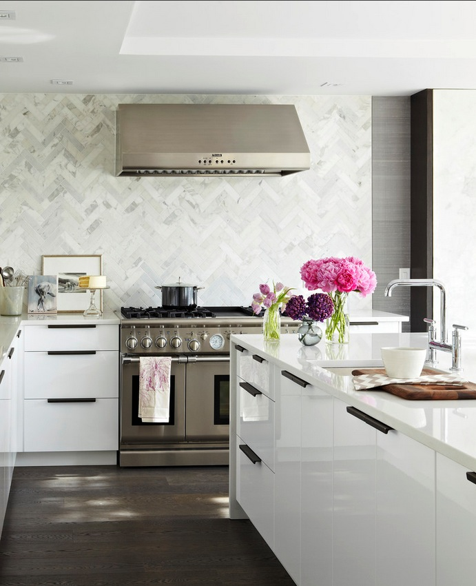 The chevron pattern creates a marble backsplash with personality and French charm.