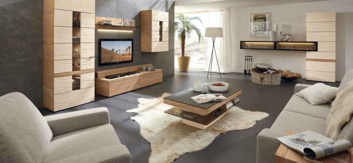This rustic modern living room extends a welcoming appeal with earthy hues of grey, warm honey woods, and white. This design is wonderfully balanced between the opposing styles.