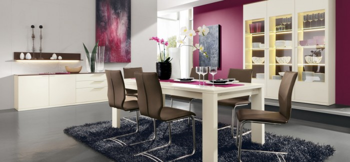 Using feminine colors and curvy furnishings alongside masculine ones of steel, dark color, and hard lines create a balanced modern style perfect for a couple.
