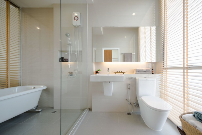 The bath is full of natural light as well from a large wall of windows.