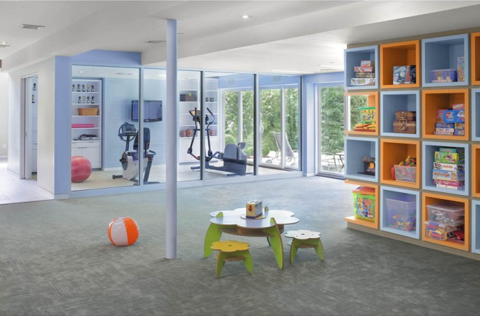 Multi-activity space such as this are a terrific way to make the most out of a basement. Parents can watch kids at play while working out in the home gym.