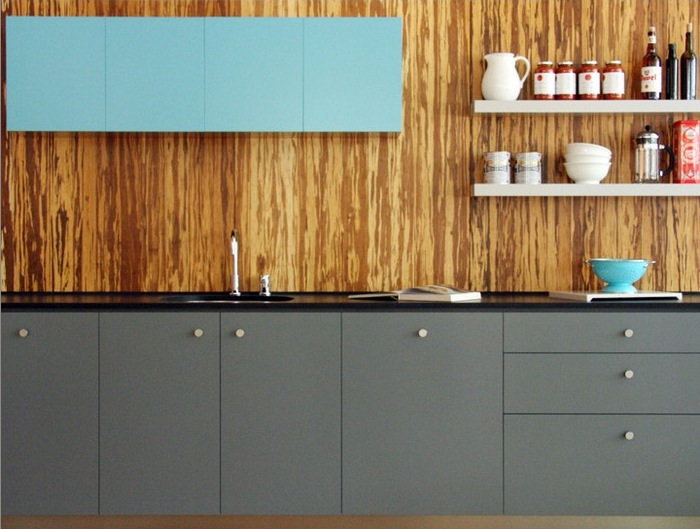 Sustainable resources such as the bamboo used for this backsplash are not only terrific for the environment, they add texture and beauty to the kitchen.