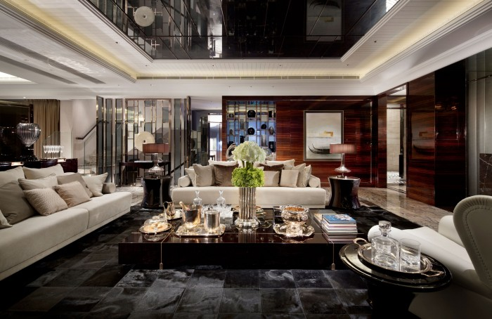 high gloss slate tiles varnished dark wood walls luxury living subtle mulberry and cream accessorized modern living steve leung