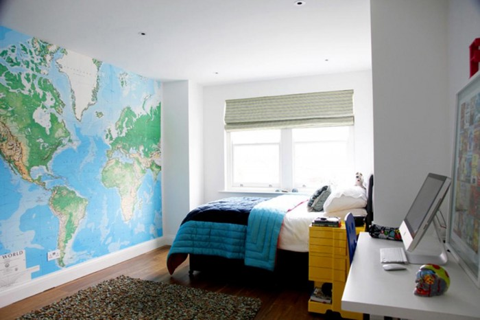 One of four bedrooms, this boy's room features a map that expands one whole wall. The colors of the map are pulled through from the wall to the bed.