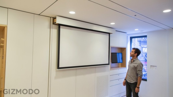 A full-size flat screen pulls out and down from the wall unit.