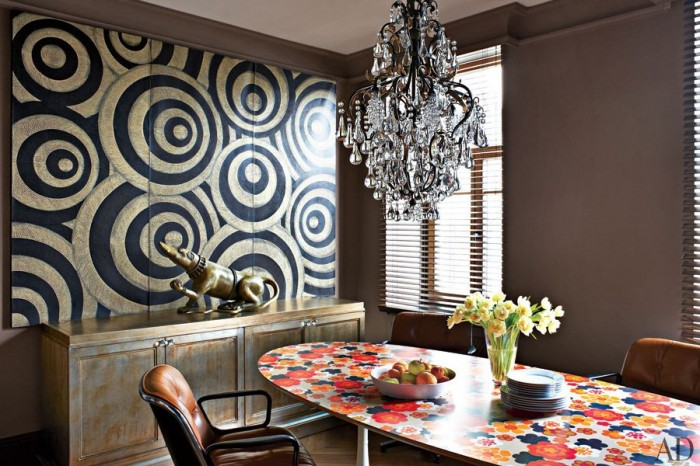 Oversize art Architectural digest- clashing print dining featuring black and gold painting