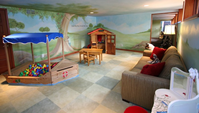 Magical hillside child's playroom with adult spaces and tree mural