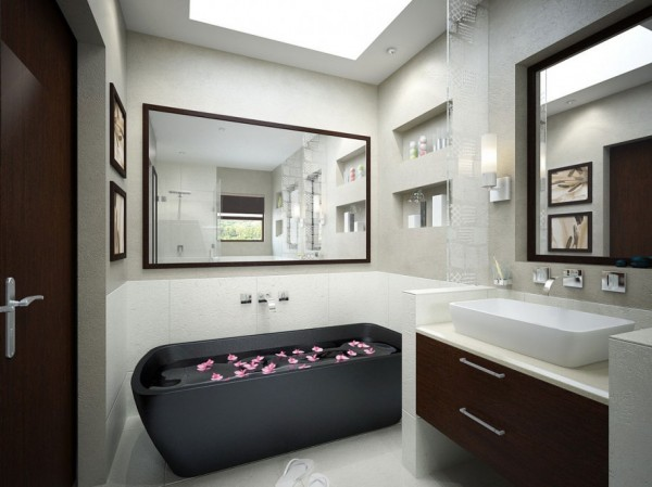 Monochrome bathroom with black tub and mirrors