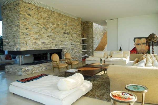 Open Plan living featuring stone wall and fireplace