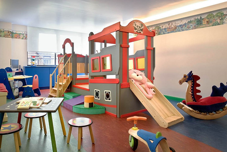 Pirate fantasy childs playroom with bordered walls and dragon