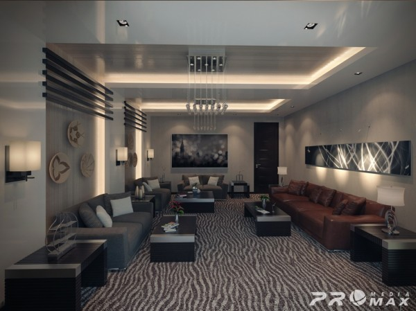 Masculine furnishings and bold pattern dominate this large open apartment living space.  Architectural elements on the walls and ceiling provide additional interest to the space.