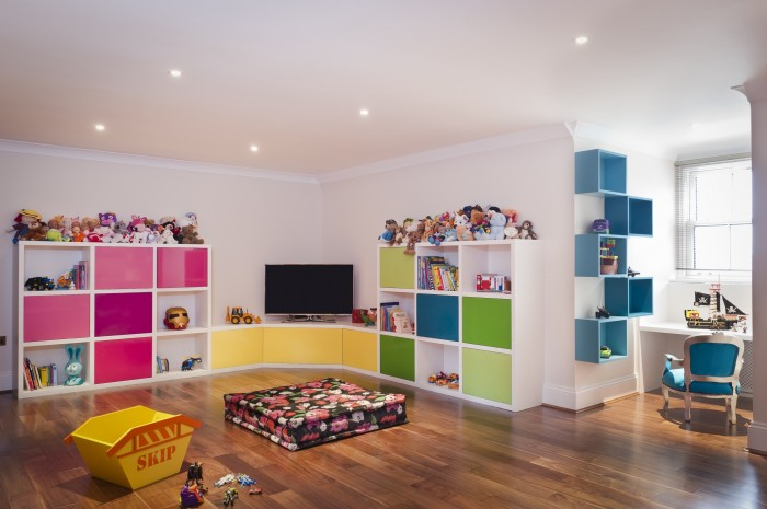 barbara-genda.com polished wood floors child's room white walls and bright color accents down-lit