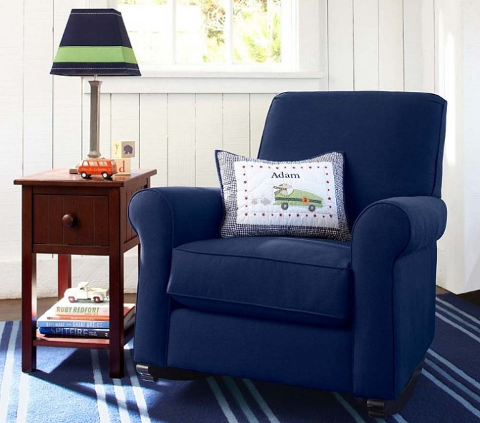 boys room sitting area blue armchair striped carpet