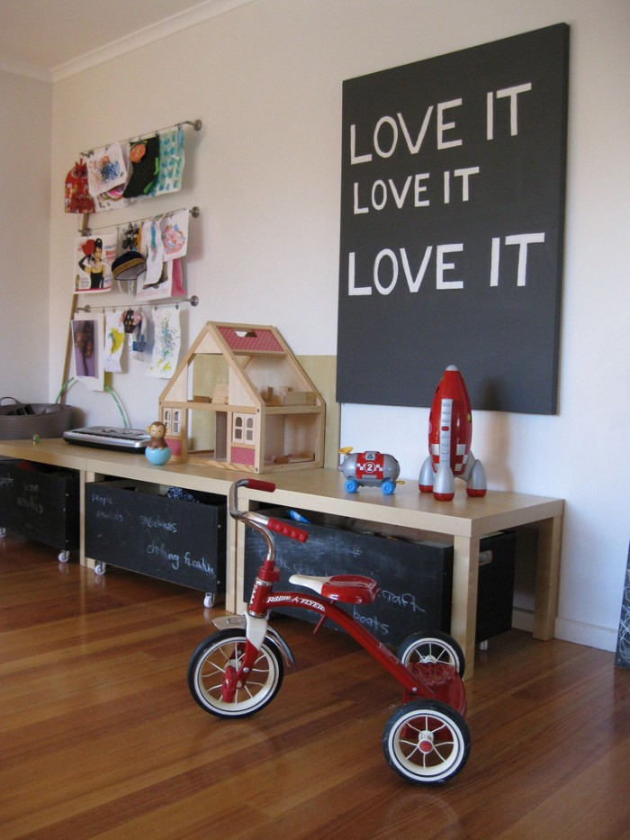 chalkboard storage and red trike child's playroom blonde wood